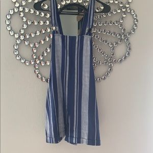 Blue and white striped overalls
